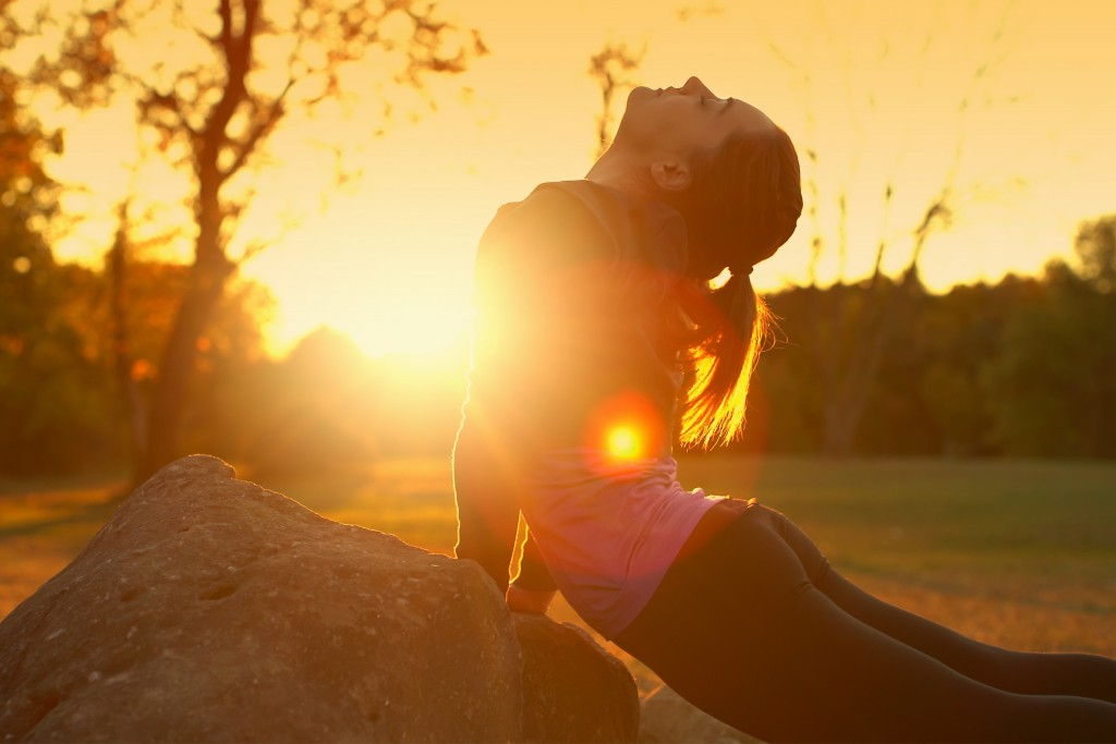 Woman Exercising in a Park at Sunset